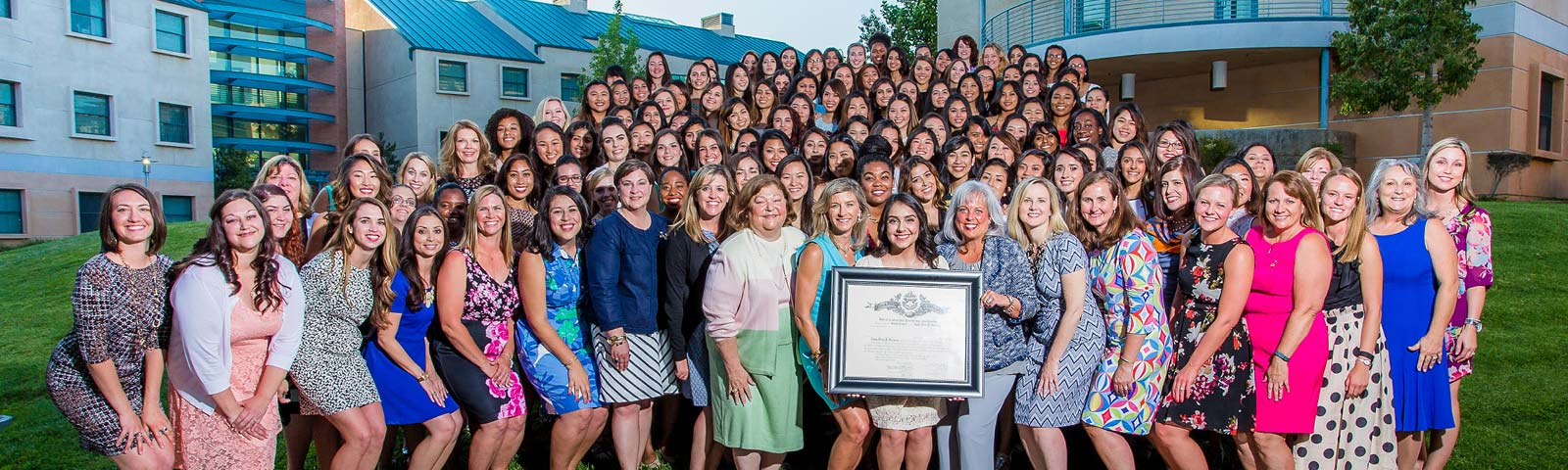 sorority installation photography example - women posing with certificate